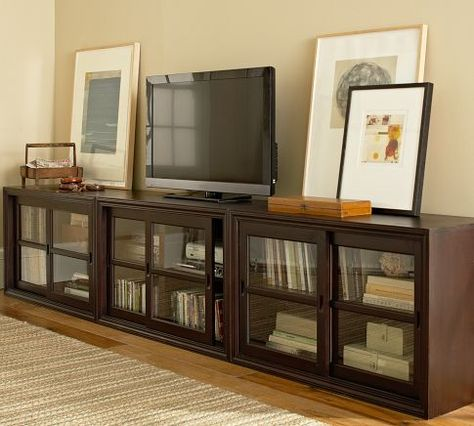 Not In This Wood Finish But I Like Long Cabinet With Tv And Art Shown Together For Living Room Wall