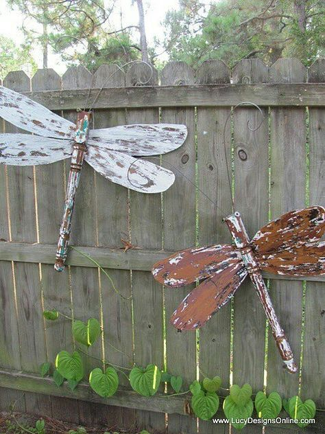 DIY Garden Art...Take old wooden ceiling fan blades when the fan quits working and create yard art, like these Dragon Flies or Butterflies. Waterseal, then polyurethane them well to prevent warping. The bodies are old table legs!