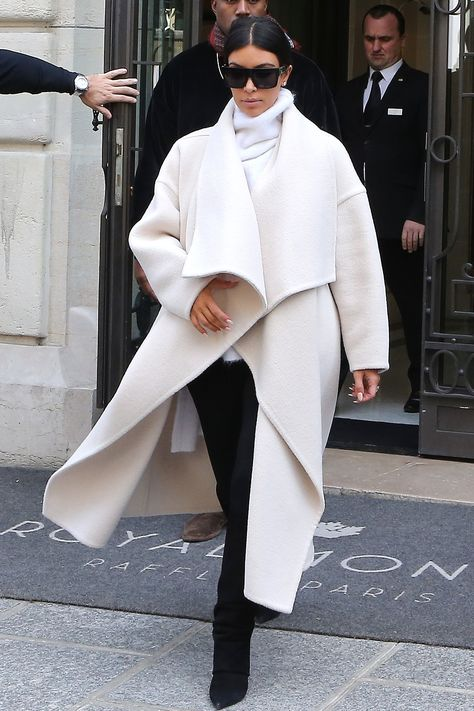 Kim Kardashian steps out at Paris Fashion Week in a luxe robe coat get the look here: - March 16 2019 at