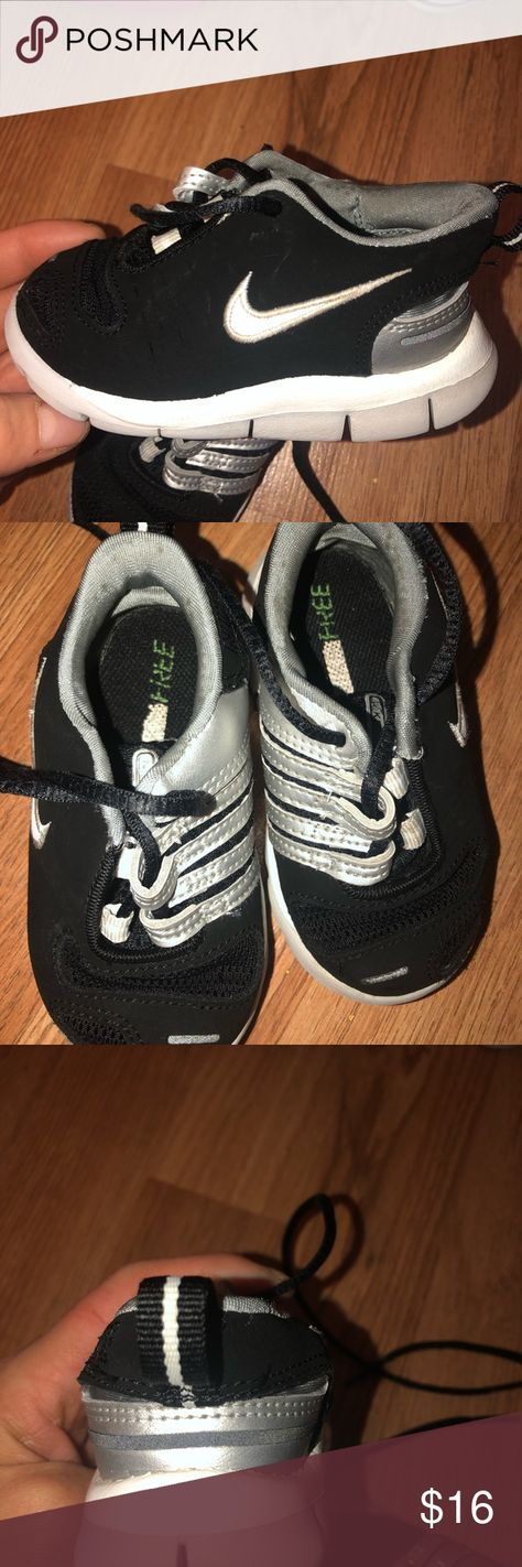 Nike Infant Size 5 Nike Infant toddler Size 5 Preloved black and white NIKE  with a touch of gray on soles. In great condition with minimal signs of  wear. e0e189e34