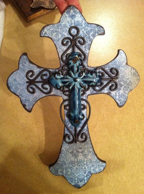 wooden cross w/blue background and iron & dark blue cross layered