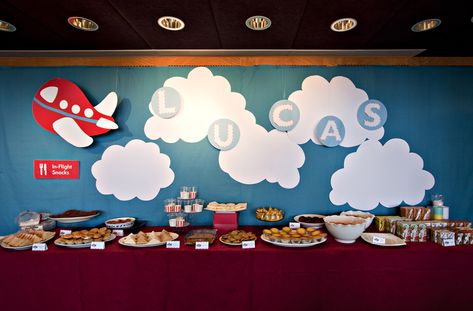Buffet backdrop for Airplane birthday party by Victoria Chow. Hang the plane and letters instead of sticking them for a better effect! Mine were hung from an air conditioning vent which gave them movement!