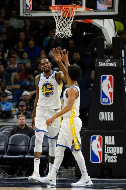 Kevin Durant And Quinn Cook Of The Golden State Warriors High Five After A Play Against The Minnesota Ti Golden State Warriors Warrior High Warriors Basketball