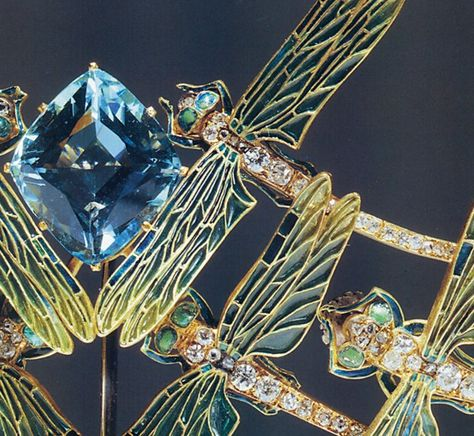Detail view of a Tiara c1900 by Lalique. Enameled Dragonflies, All Flying Towards A Large Aquamarine Stone.