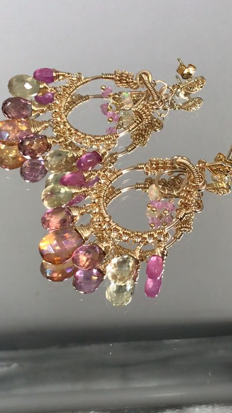 Glamorous gold fill hoops dangle feminine gemstones of mystic tangerine quartz, pink topaz, pink sapphire and lemon quartz centered by opals and sapphires. by Doolittle Jewelry