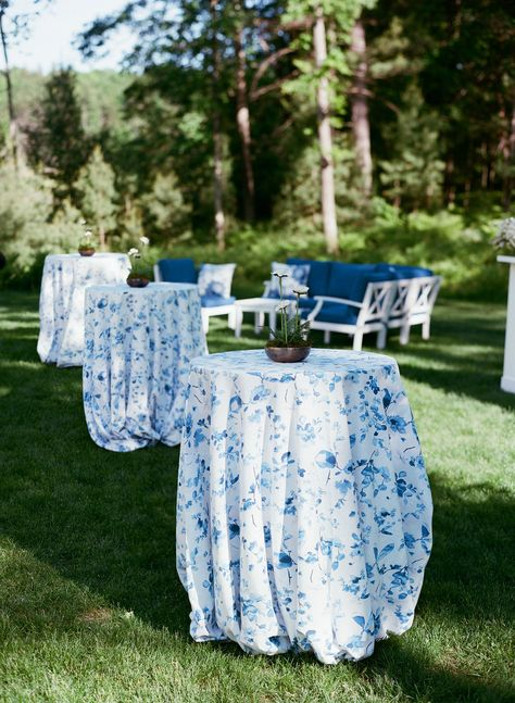 Incorporate summer-inspired colors into your wedding day with royal blue flower prints for a homey cocktail hour. Click through for more rustic wedding ideas! #rusticwedding #tablelinens #cocktableideas #blueweddingideas #summerwedding #cocktailhour