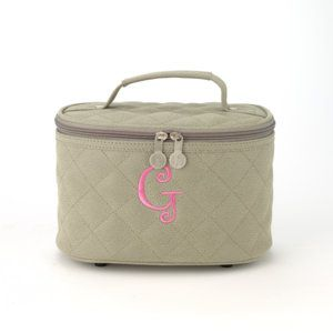 """Train Case - Pewter  9.5""""W x 6""""H x 7""""D  Our new Train Case is ready for your trip! Large, open interior can store toiletries, medicines, first aid items... you name it! Small mirror in the top allows for a quick lipstick touchup. It has a zip top closure and handle for easy carrying. Available in 8 mouth-watering colors! Black, Chocolate, Pewter, Berry, Koi, Daffodil, Scarlet and Green Tea in Quilted Pebbled Faux Suede. Price: $30.00. www.myinitials-inc.com/jgorgei"""