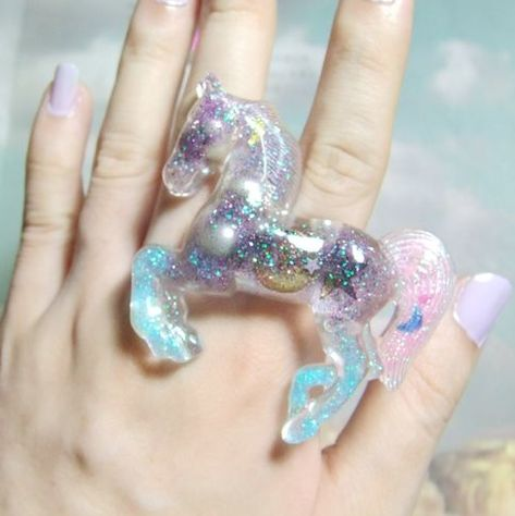 Unicorn power ring. Woah. I love the quirkiness of this ring. I love the different colours of glitter and how they describe a fantasy creature