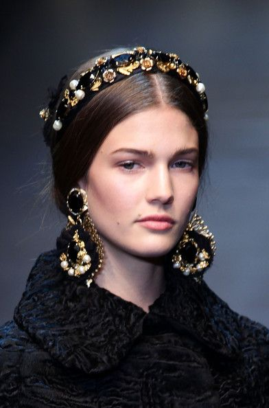Hairpiece and earing detail as a model walks the runway at the Dolce & Gabbana Autumn/Winter fashion show as part of Milan Womenswear Fashion Week on February 2012 in Milan, Italy.