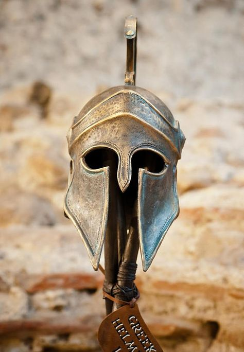 Ancient Greek Corinthian war helmet with long crest. Similar helmets were worn by the Greeks during the Persian Wars. The Corinthian style helmet appeared at the end of the 8th c. BC. and remain in use until the Classical period. The way it is set up is handmade. Sculpture of the