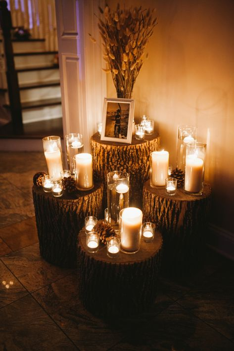 Rustic and romantic wedding decor with logs and candles at lakeside wedding venue in NJ | Photo: Sanford Creative