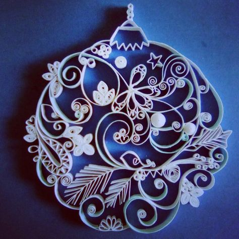 This quilled paper artwork named Merry Christmas!!! is handmade from white and light blue strips of paper. The size of the hearth is approx. 9x10cm (approx. 3,5x3,9 inches). The base paper of the artwork is 15x15cm (approx. 5,9x5,9 inch). Its placed in a deep frame, frame size is