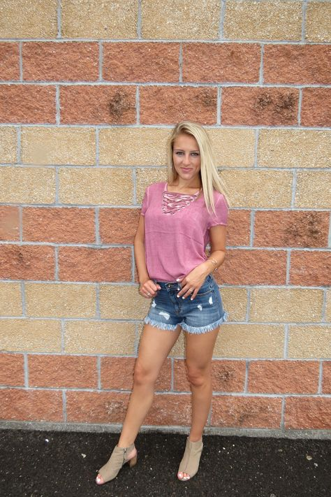 - cute meets comfy with this top! - perfect color for summer & paired with our Medium Wash Cut Offs - love the lace up detail & mineral washed look - model is wearing a small, runs true to size!