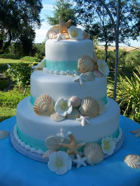 Beach Theme Wedding Cake Fondant cake with white chocolate shells and gumpaste flowers