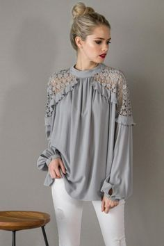 Kaylas Armoire Lace shoulder Blouse In a flowy silhouette, this lace shoulder blouse features sheer crochet detailing on the shoulders. Button closures at the front neck.