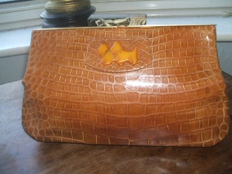 Beautiful 1930 blond baby crocodile skin purse with Bakelite scotty dogs on the front