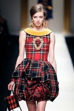 Moschino queen like dress. The different colour tartan makes this an unusual but statement piece