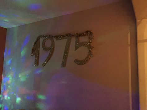 """""""1975""""cut out of foam board covered in glitter for photo backdrop"""