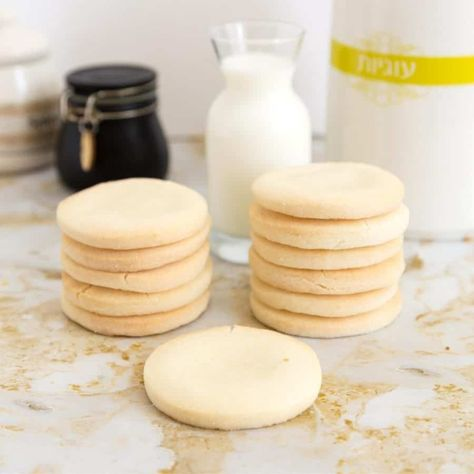 These gluten-free sugar cookies are made using rice flour. The recipe has no eggs so the color of these cookies is also white. As kids, we called them 'snow white cookies'. Just like sugar cookies, these rice flour sugar cookies are crisp and crumbly. They hold their shape well and can be used to make beautifully frosted cookies. #riceflour #cookies #glutenfree #rice #sugarcookies #cookierecipes