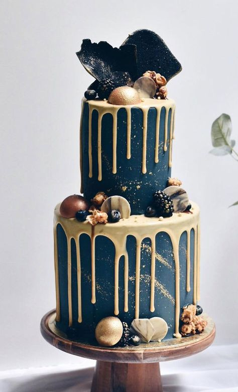 Gold drip wedding cake with chocolate and sweet topped Beautiful Wedding Cake, wedding cake ideas, winter wedding cake, gold drip twedding cake,pretty navy blue wedding cake