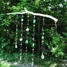 Bohemian windchime made from wire, stones and recycled chandelier crystals.