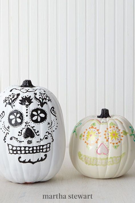 Dia de los Muertos, or Day of the Dead, is a Mexican holiday that occurs the day after Halloween—and these sugar-skull-themed designs were created in honor of it. Their look was inspired by a staffer's recent travels to San Miguel de Allende, Mexico, and their traditional Day of the Dead celebrations. #marthastewart #pumpkins #diypumpkins #falldecor #halloween