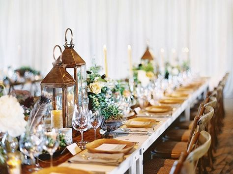 Tablescape with lanterns and rustic elements.