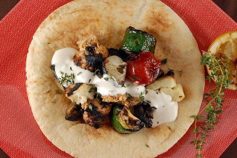 shish taouk with toum chicken kebabs with garlic sauce recipe food 52 garlic sauce cooking on the grill pinterest