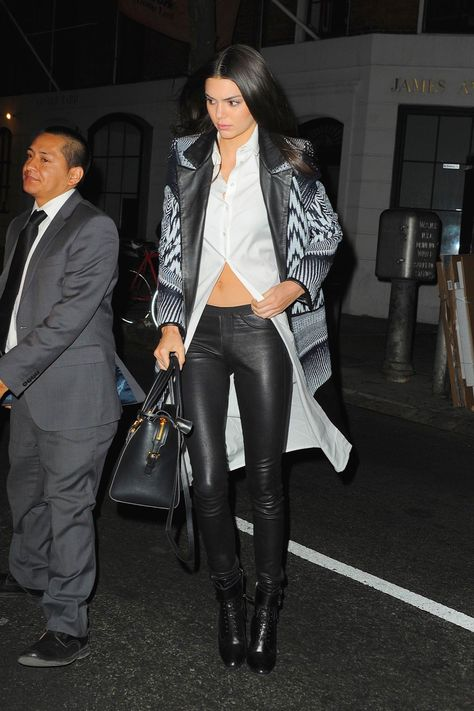 Kendall Jenner wearing Balenciaga Leather Leggings, Prada Top-Buckle Lace-Up Booties, Versace Black Leather & Gold Medusa Medallion Tote Bag, Sass & Bide Fall 2015 Coat and Michael Maven Oversized Bomber Jacket with Round Bottom Detail in Black