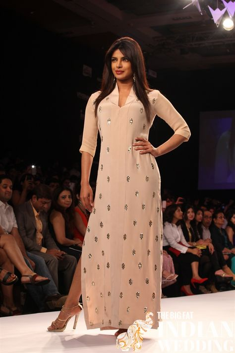 Priyanka Chopra graced the runway during the Lakme Fashion Week (LFW) Summer/ Resort 2014 in Mumbai, India on March 2014 to display a creation by fashion designer Neeta Lulla.