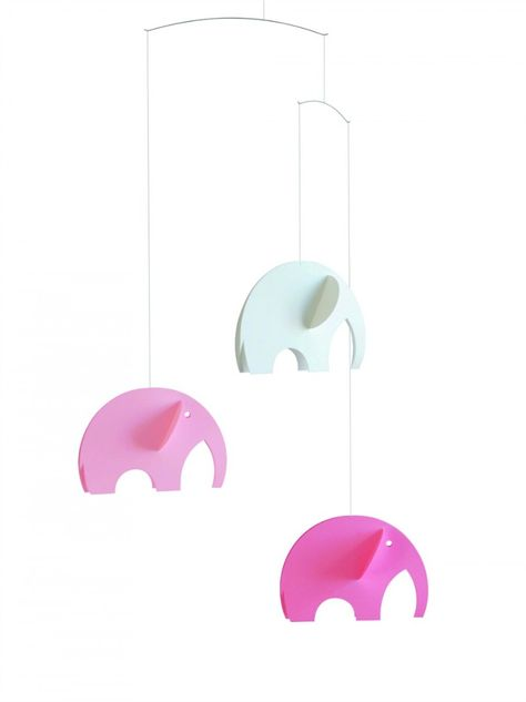 Handmade pink elephant mobile from Flensted to hang over the nursery crib.