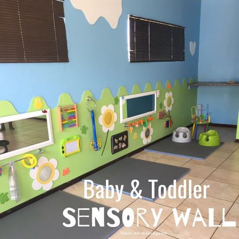 Sensory Wall for Baby & Toddler - Teach Me Mommy - Sensory Wall for Baby & Toddler – Teach Me Mommy A fantastic sensory and activity wall for babies & toddlers! Toddler Daycare Rooms, Infant Toddler Classroom, Daycare Spaces, Childcare Rooms, Preschool Rooms, Home Daycare Rooms, Daycare Nursery, Infant Daycare Ideas, Toddler Activities For Daycare
