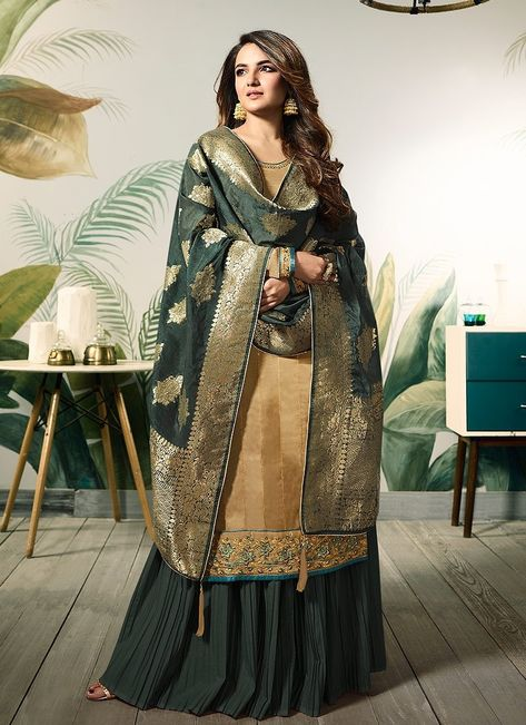 Yellow And Green Embellished Satin Palazzo Suit shows combination of embossed zari, thread and stone work detailed embroidery on heavy georgette satin top paired with fancy satin santoon bottom and lining and classic digital printed banarasi silk dupatta.