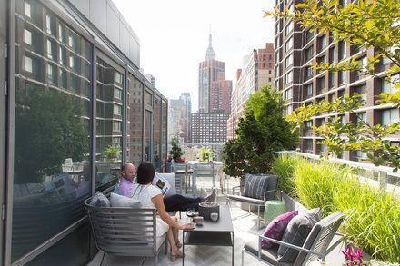Designerlen Berlin swimming pond balcony design idea bushes wooden deck relaxing