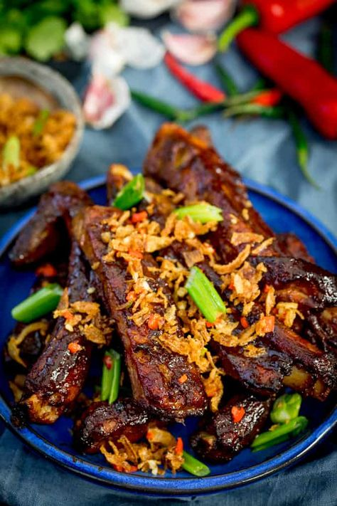 How about theseOven Baked Asian Ribs with Crispy Onions for Chinese New Year? Slow cooked in the oven until tender, then brushed with a sticky marinade and finished with crispy onions! #Asian #ChineseNewYear #Chinese #Takeout #Recipe ChineseFood