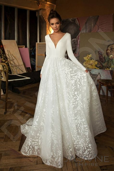 This A-cut wedding dress is made out of crepe, guipure, and tulle.  Designed and handmade in Europe this dress can be sewn custom to your measurements and has other customizable options.  *The price doesn't include accessories.  **All of your gowns are offered to be sewn fully upon the individual