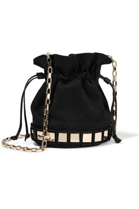 Black bucket Bag with gold details,Tomasini. Bag Trends Fall 2016. Bolso saco negro con detalles dorados, Tomasini. Tendencias Otoño 2016. Schwarze Sack-Tasche mit goldenen Details, Tomasini. Trends Herbst 2016