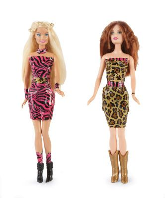 Since most of the real Barbie clothes always look like hooker wear and my kids love that crafty patterned duck tape...