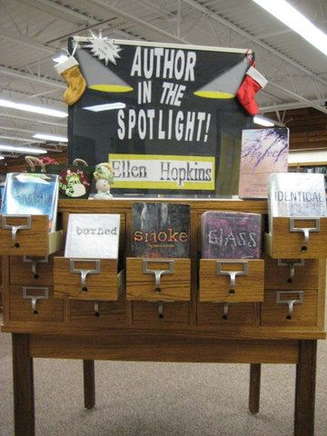 Author in the Spotlight Display - Using the old card catalog table to showcase the books of a particular author.
