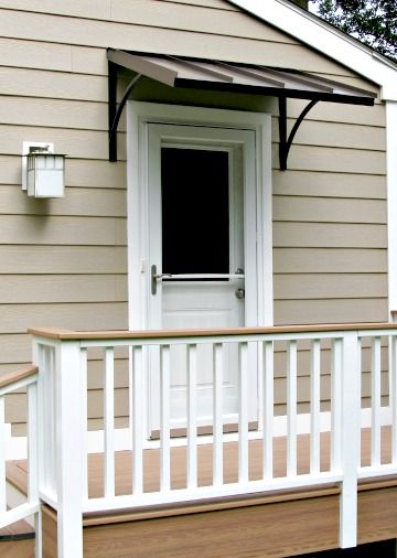 The Bronze Metal Classic Door Awning With The Smith Scrolls In White Plains Ny Door Awnings Custom Awnings Metal Door Awning