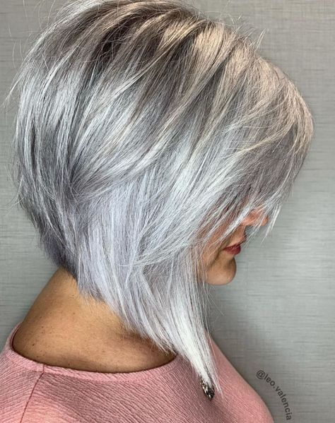 Steeply Angled Silver Bob with Layers A sleek inverted bob in bright silver is an eye-catcher in any age. The straight hair is parted on the side and has long wispy feathered bangs. If you don't mind some drama in modern haircuts to keep you loo Long Bob Haircuts, Modern Haircuts, Short Bob Hairstyles, Pixie Haircuts, Wedding Hairstyles, Braided Hairstyles, Celebrity Hairstyles, Modern Bob Haircut, Layered Bob Haircuts