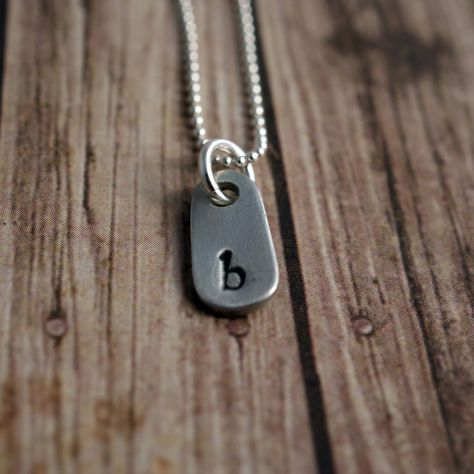 http://www.fashionnewswebsites.com/category/initial-necklace/ teeny tag initial necklace. See 1 more picture