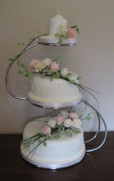 Two Tier Wedding Cake Displayed On S Shaped Stand With Candle Topper Cakes And Sweets In 2018 Stands