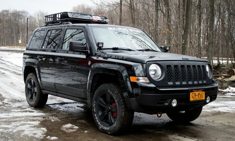 Lifted Jeep Patriot. 235/65r17 Cooper Discoverer AT3 tires, 2.125in RRO spacer lift, Curt Roof Basket, Mopar Roof Rails, Led light pods on custom brackets, fire stick door jamb CB mount, 2 foot CB antenna. 2013 Jeep Patriot Latitude