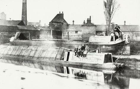 """Caption: """"Narrowboat stranded on the canal bank in Brentford due to flooding"""""""