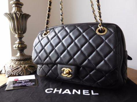 d9d319af7d265c Chanel Camera Flap Bag in Black Lambskin with Aged Gold Hardware - SOLD    Chanel   Bags, Gold hardware, Black
