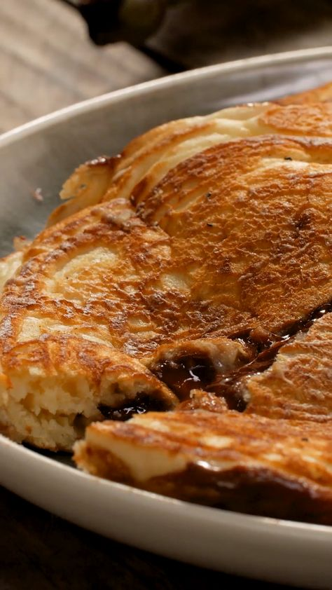 You've had pancakes topped with banana and Nutella, but have you tried filling them for an ooey gooey center?