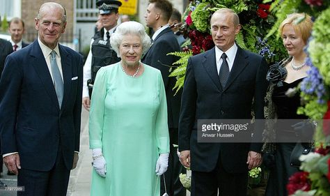 Queen Elizabeth and the Duke of Edinburgh are greeted by Russia's President Vladimir Putin and his wife Lyudmila Putina as they arrive for a banquet at Spencer House in London on June 26, 2003.