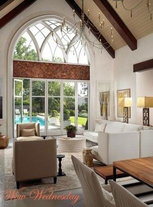 Rustic Luxe Living Area With A Cathedral Window Overlooking A Pool Living Room Windows Pool House Mid Century Modern Living