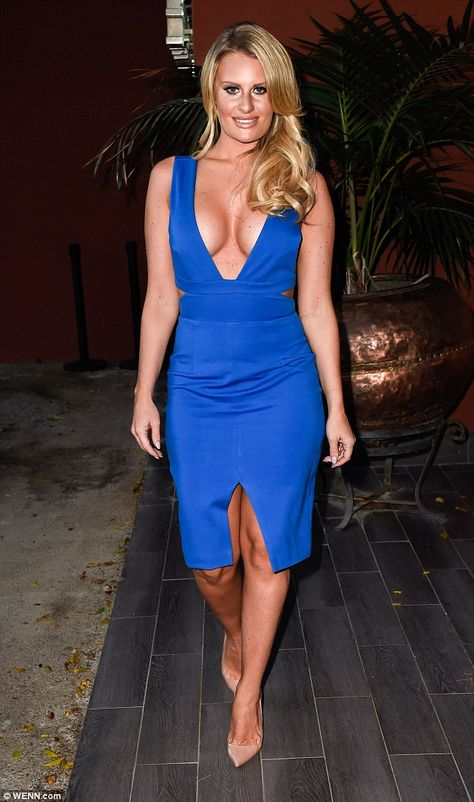 Taking the plunge: Danielle Armstrong showed off her ample cleavage in a low-cut blue numb...